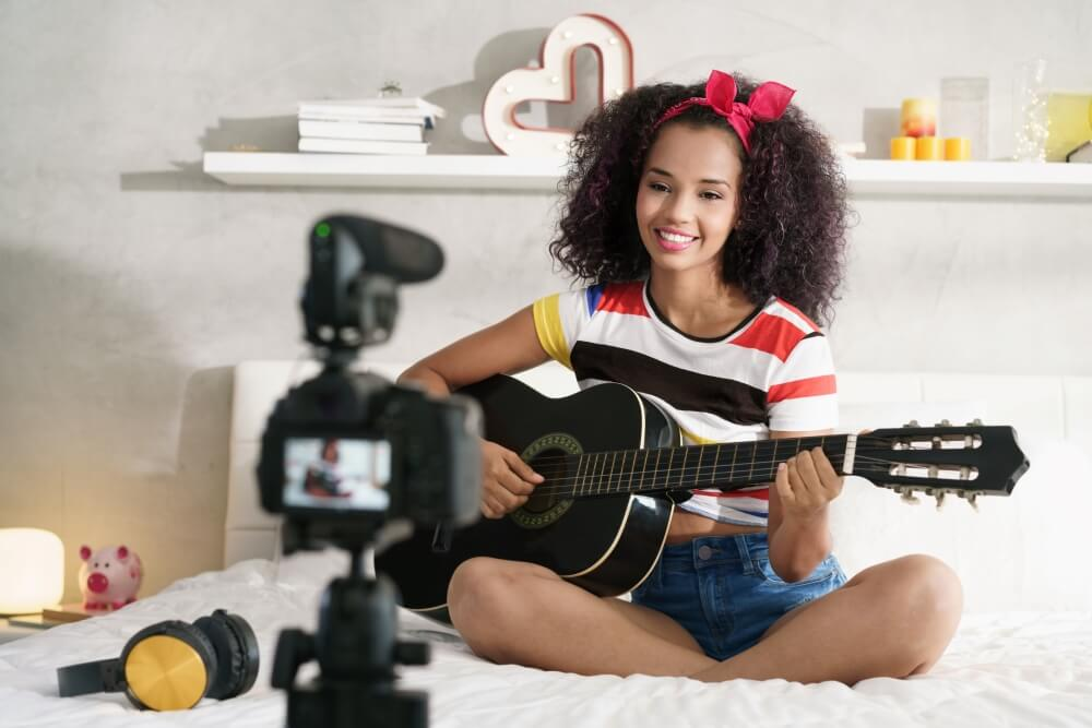girl-at-home-playing-guitar-young